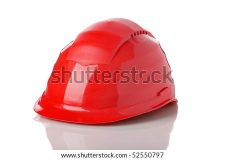 red safety helmet as used by construction workers isolated on white