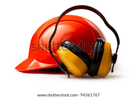 Red safety helmet with earphones - stock photo