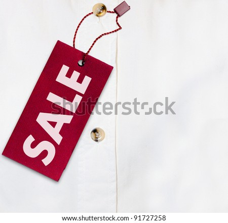 Red Sale Sign on White Shirt - With Copyspace