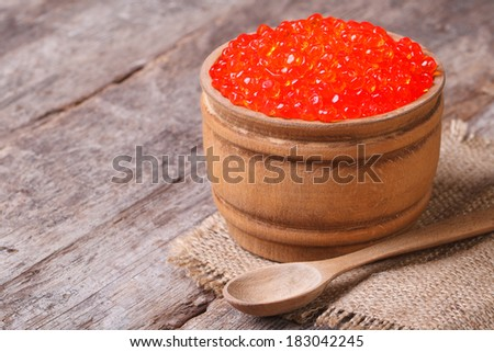 red salmon caviar in a wooden keg on the old table. closeup. horizontal  - stock photo
