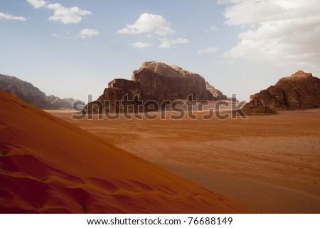 Red sand dune in Wadi Rum desert - wideangle - stock photo