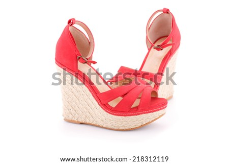 Red sandals isolated on white background. - stock photo