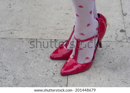 red sandals with socks with hearts   - stock photo