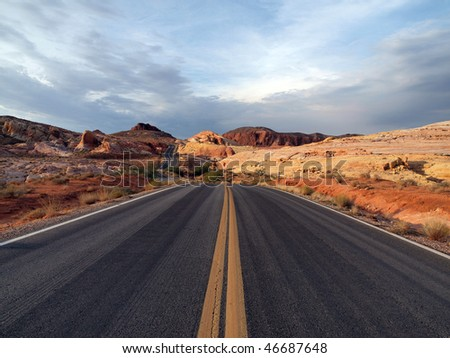 Red Sandstone highway and storm clouds at Valley of Fire, Nevada. - stock photo