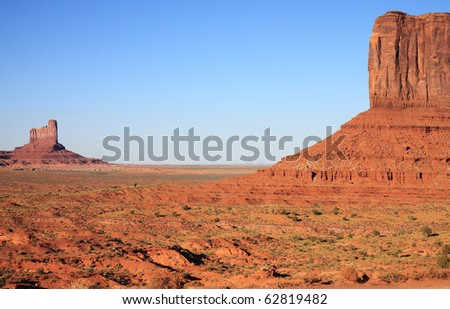 Red sandstone rock formations give Monument Valley an unearthly looking landscape that is unique and interesting to visit