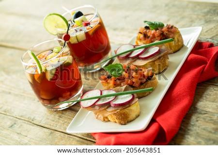 red sangria and bruschetta - stock photo