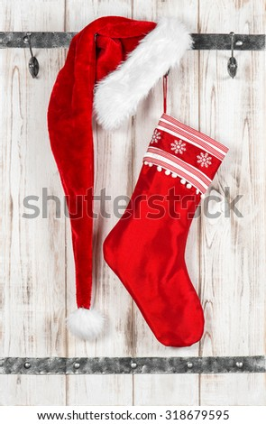 Red Santa Claus hat and sock for gifts. Vintage style christmas decoration