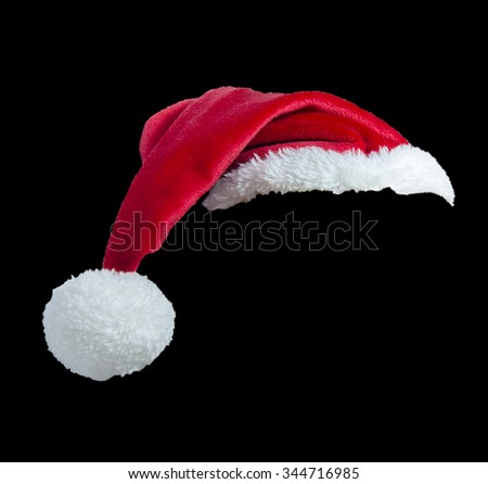 Red Santa clause hat isolated on black background