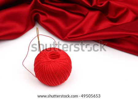 red satin and thread