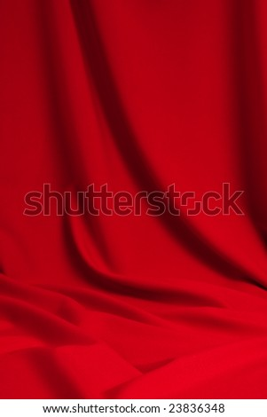 Red satin background; soft silk fabric drapery as background; abstract background luxury cloth; wavy folds of silk texture velvet material; empty place to put your object - stock photo