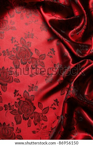 Red satin background with copy space - stock photo