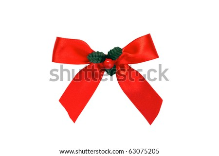 Red satin Christmas bow with holly isolated on a white background - stock photo