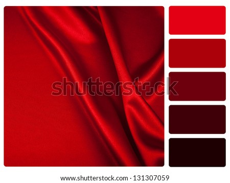 Red satin color palette with complimentary swatches. - stock photo