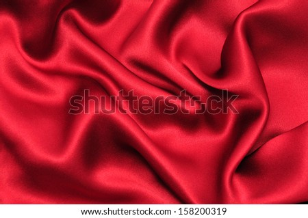 Red satin fabric background - stock photo