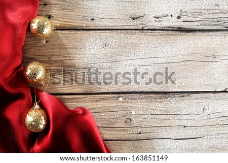 red satin gold balls and brown desk  - stock photo