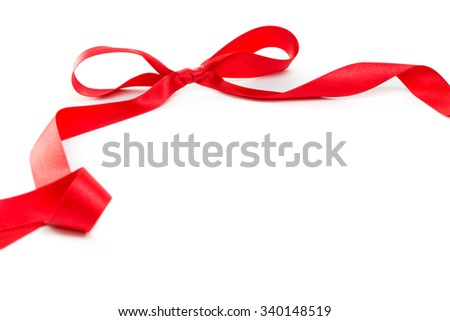 Red satin ribbon with bow on white background, with copy space - stock photo