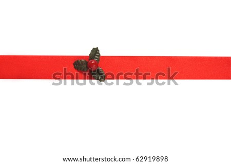 Red satin ribbon with holly for Christmas isolated on white background