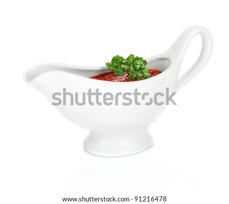red sauce with greenery in sauceboat isolated on white background - stock photo