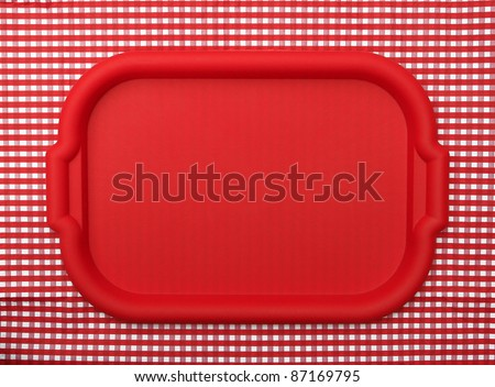 Red School Lunch Serving Tray / Plate isolated on red and white checkered background - stock photo