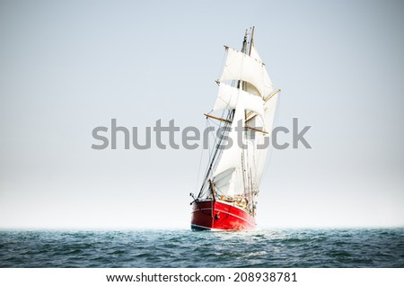 Red schooner sailing on the baltic sea. - stock photo
