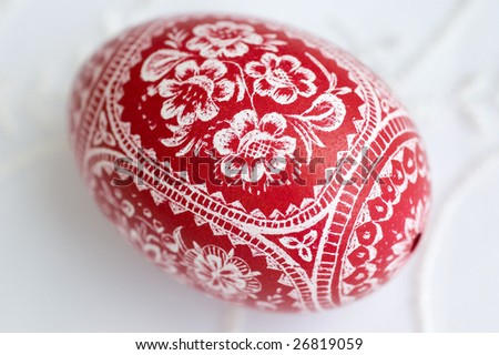Red scratched traditional Polish easter egg - stock photo