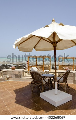 Red sea beach with parasols and beach bar - stock photo