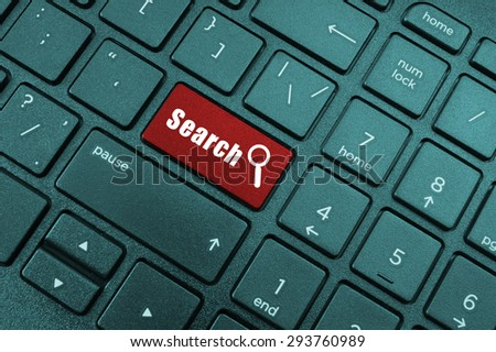 Red search button on the keyboard close-up - stock photo