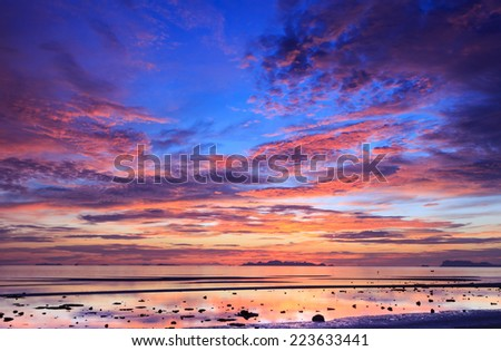 Red seascape sunset blue sky background