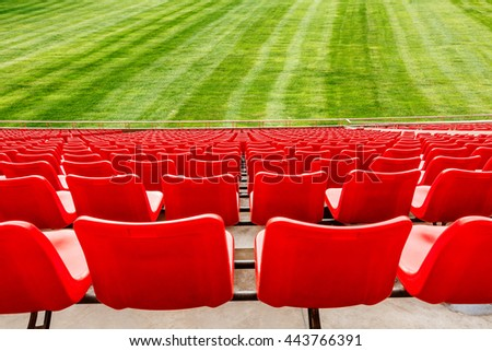 Red seats in a open stadium