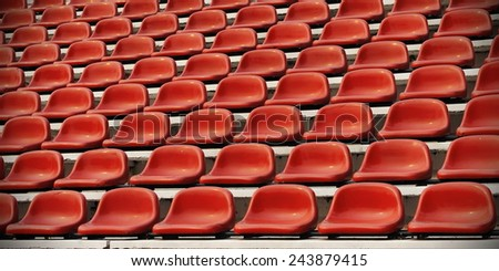 Red Seats in a Sports Stadium  - stock photo