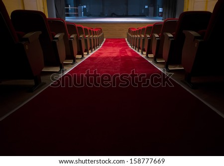 Red seats in a theater and opera - stock photo