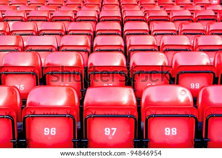 Red Seats in Stadium - stock photo