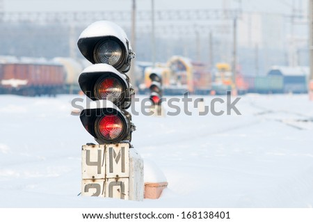 Red semaphore lights on modern cargo railway. Road closed due to bad weather - stock photo