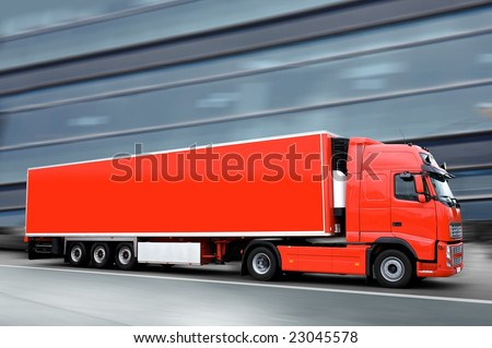 red semi truck in the street - stock photo