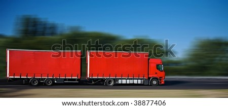 red semi truck with trailer on highway - stock photo