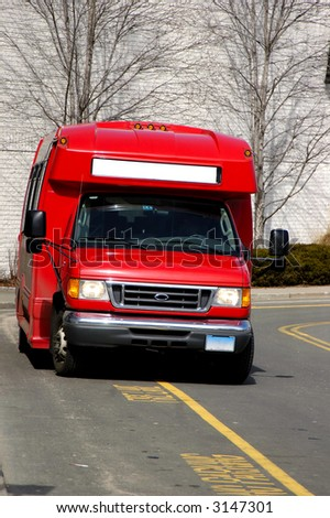 Red Service van ready to pick passengers on a local mall - stock photo