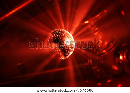 Red shining discoball / mirrorball in motion - stock photo