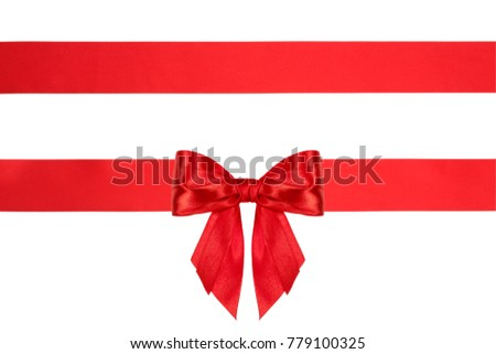 Red shiny bow with ribbons with long ribbon extending on both sides isolated on white.
