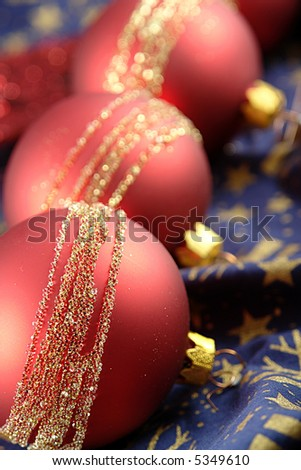 Red shiny christmas balls on a christmas background