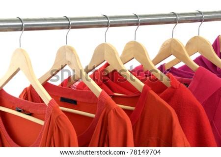 Red shirt rack on white - stock photo