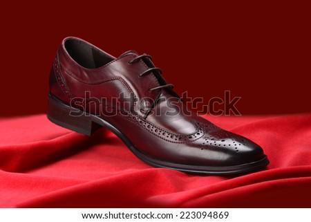 Red shoe - man's casual shoe - stock photo