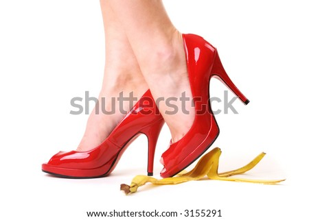 Red shoes and a banana skin - stock photo