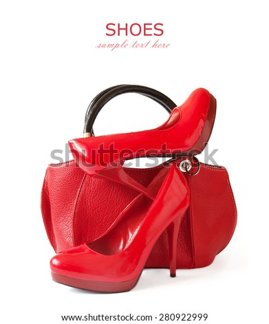 Red shoes pair and hand bag isolated on white background - stock photo