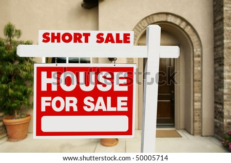 Red Short Sale Real Estate Sign and House. - stock photo