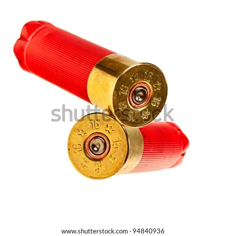 Red shotgun shells isolated over white background. - stock photo