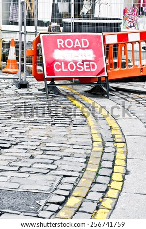 Red sign indicating a road closed due to construction work - stock photo