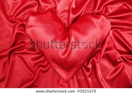 Red silk cloth in the form of the heart - stock photo
