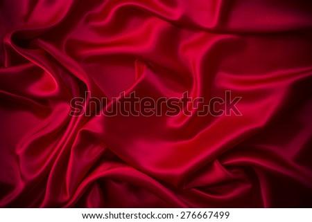 red silk fabric background  - stock photo