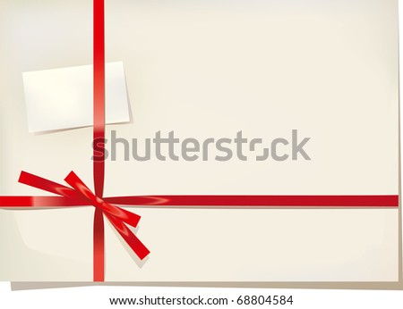 Red silk gift bow and card - stock photo