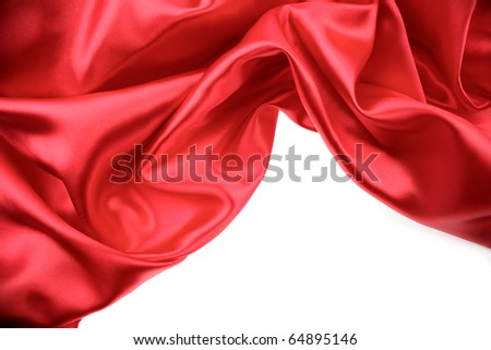 Red silk on white background. Copy space